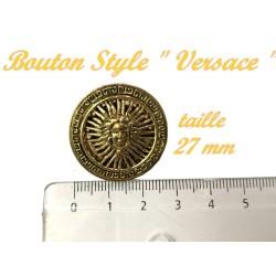 Bouton doré métal à coudre en taille 27 mm.
