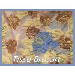 Tissu Brocart Couture En Motifs Fleurs FLoqués Couleur Jaune, Bleu Et Bronze Pour La Création De Robes, Tailleurs Et Caftans.